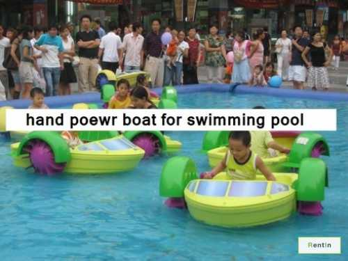 Hand power boat for swimming pool.